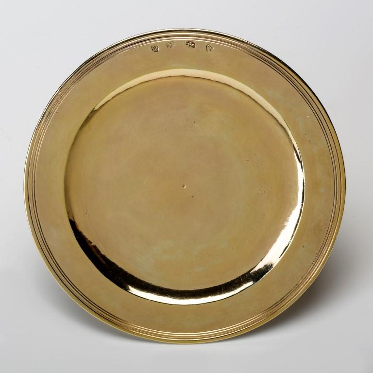 A circular silver-gilt paten, Simon Owen, London, 1609.